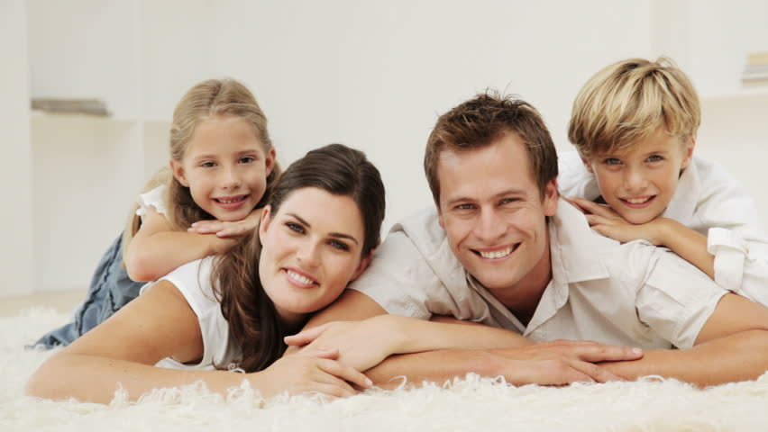 Family Embrace And Smiles On A Beach Stock Footage Video -2568