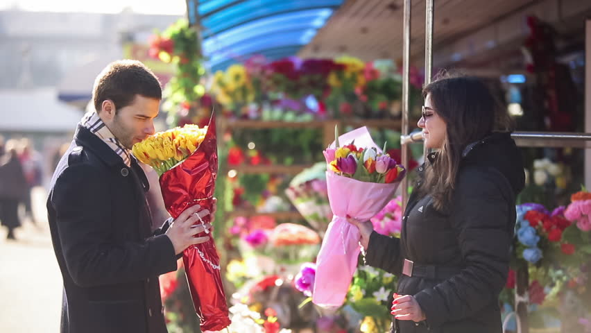 Man buying flowers in a street shop