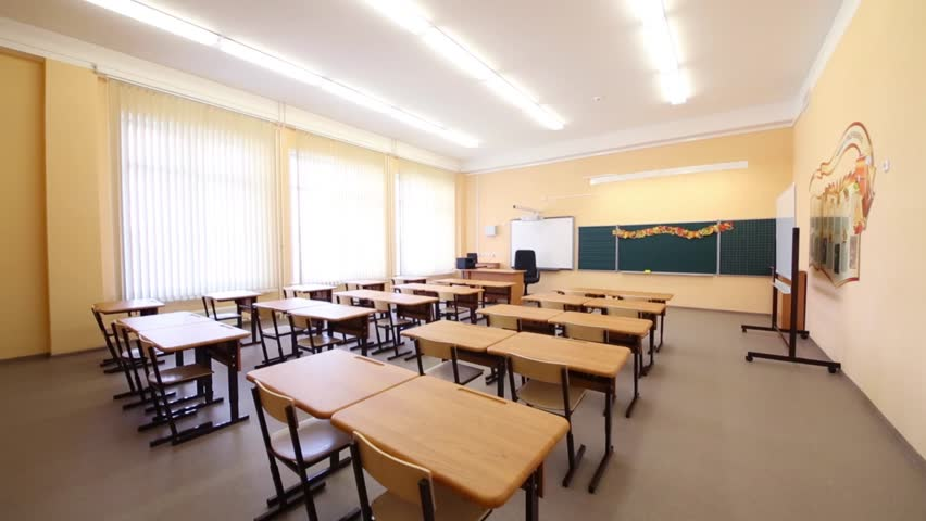 Modern White Classroom ~ New modern school classroom with chairs on desks at sunny
