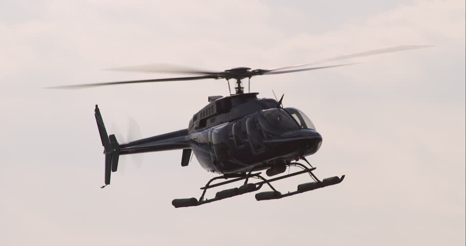 Black helicopter coming in and landing at the Downtown Manhattan Helipad near the South Street Seaport