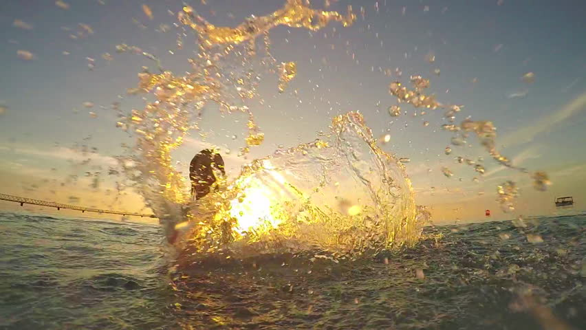 SLOW MOTION: Young woman splashing the water into camera #9326384