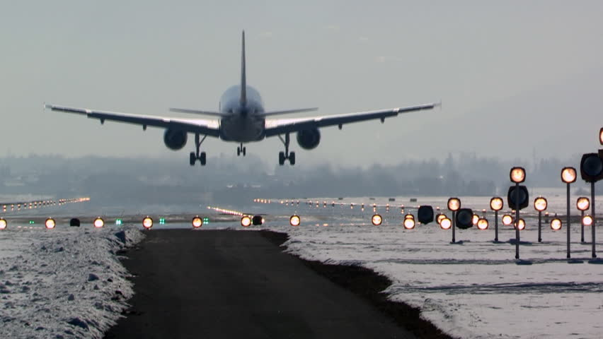 aircraft landing in airport, winter