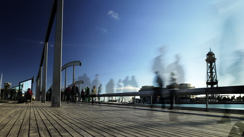 time-lapse of people on a boardwalk