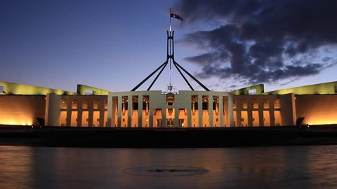 PARLIAMENT HOUSE, CANBERRA - FEBRUARY 2015: Night timelapse of Parliament House, the meeting facility of the Parliament of Australia located in Canberra, the capital of Australia.