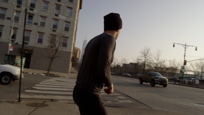 Boxer Training - Sparring by Hudson River on Westside Highway - Silhouette of Man Throwing Punches - Sun Beaming - Slow Motion 4K - Manhattan New York City - Gritty NYC
