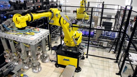 Novosibirsk March 31: Robots loaders work in a warehouse bottled water. Novosibirsk, Russia. March 31, 2015.