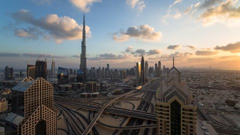 Dubai, United Arab Emirates - CIRCA DECEMBER 2014: The Burj Khalifa Dubai, elevated view across Sheikh Zayed Road and Financial Centre Road Interchange, time-lapse