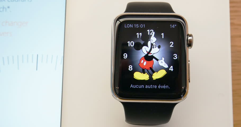 PARIS, FRANCE – APR 10, 2015: Apple Apple Watch with Mickey Mouse watch face. Apple Watch is the most wanted gadget of 2015