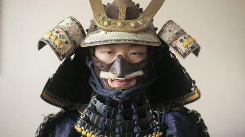 ancient Japanese samurai opens up his sword, close-up