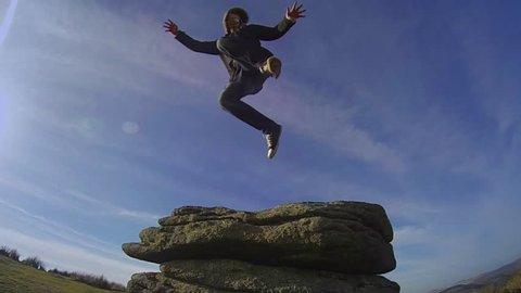 Super Slow Motion - Man Jumps Off Rocks