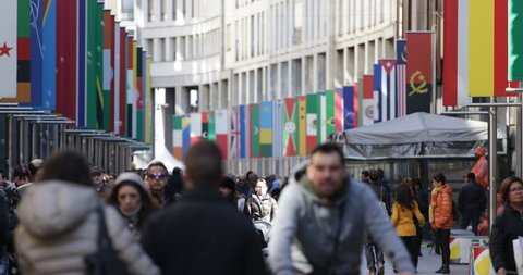 MILAN, ITALY - MARCH 8, 2015 Rush Hour Milan Shopping Crowded Street Crowd Walk Busy City Expo 2015 Flags Day ( Ultra High Definition, UltraHD, Ultra HD, UHD, 4K, 2160P, 4096x2160 )