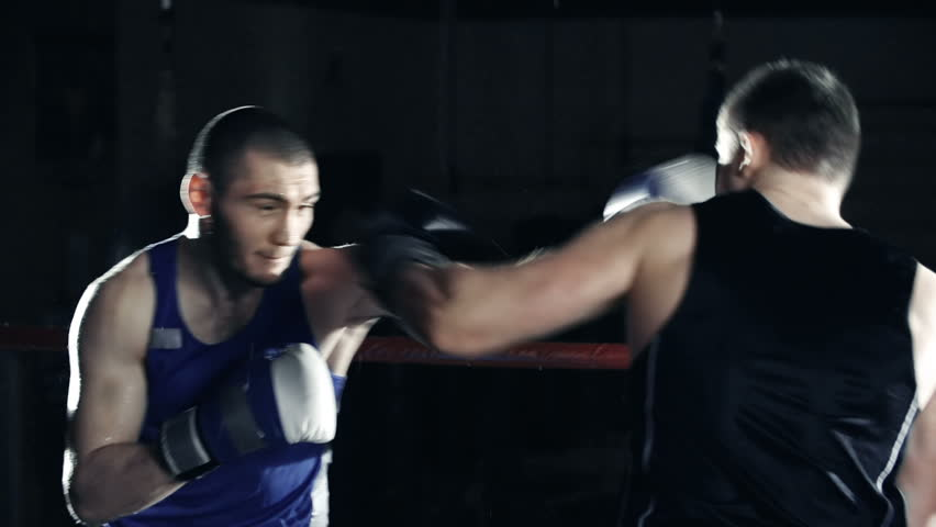 Slow motion of two boxers sparring