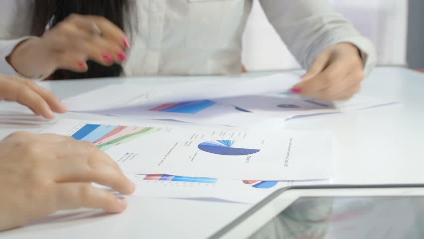Businesswomen meeting: financial analysis with printed financial charts | Shutterstock HD Video #9609770