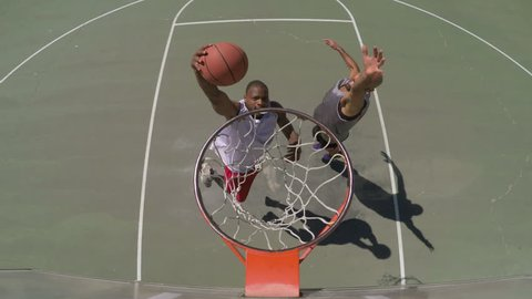 Overhead Angle of Two People Playing Basketball Outside