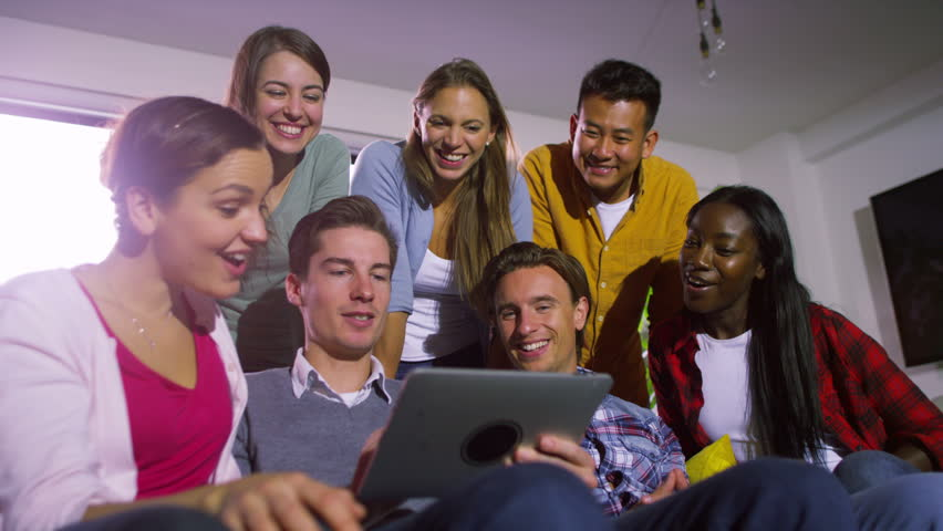 4K Cheerful group of young friends hanging out together with computer tablet | Shutterstock HD Video #9655514