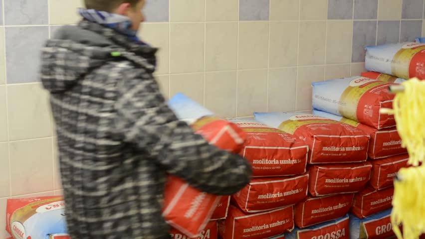 PRAGUE, CZECH REPUBLIC: MARCH 1, 2014: Storekeeper consists flour