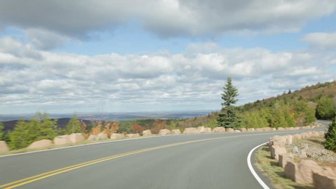 POV clip driving on Cadillac Mountain road (part of the Park Loop Road) in autumn in Acadia National Park.