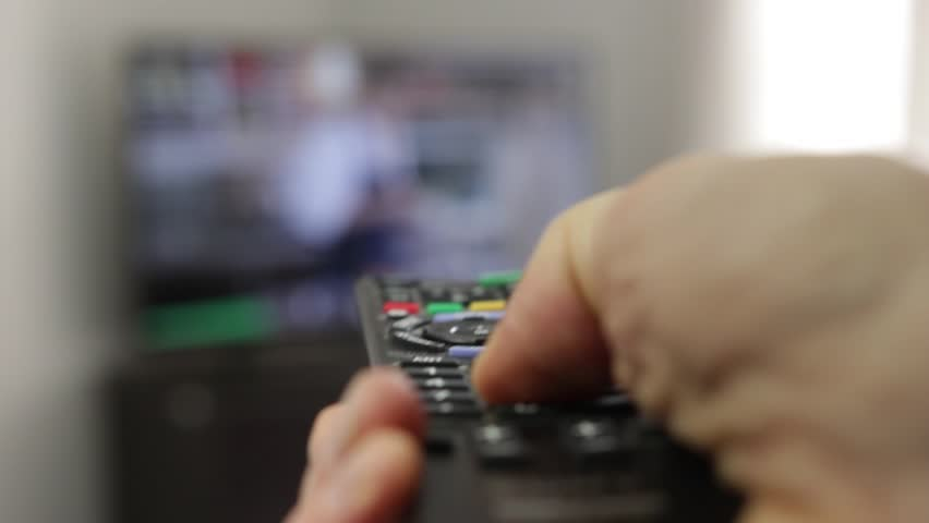 Hand with remote control in front of tv set | Shutterstock HD Video #9675704