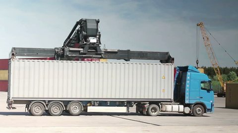 Container Handler unloading a Truck in Port Terminal