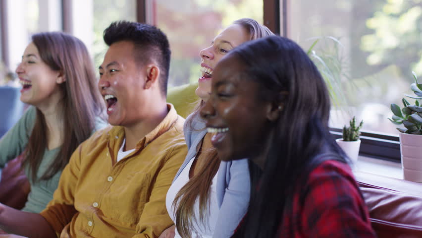 4K Happy group of young friends hanging out together and watching TV | Shutterstock HD Video #9685694
