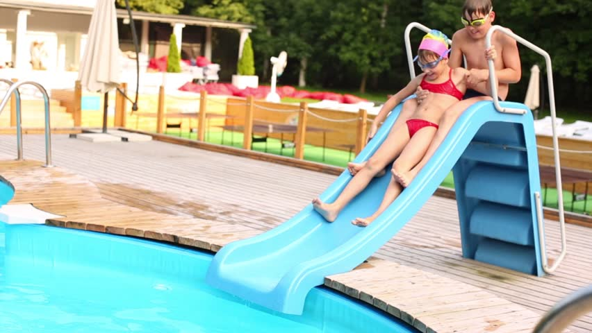 70ea58650a539 Little Girl and Boy Slide Stock Footage Video (100% Royalty-free ...
