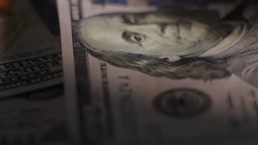 Money Dollars rotate on the table. Close-up. shadow | Shutterstock HD Video #9700094