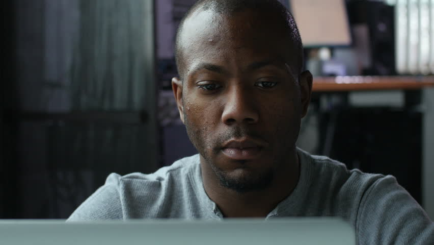 African American man working on a laptop at work | Shutterstock HD Video #9716774