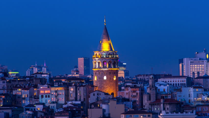 ISTANBUL - APRIL 02: Day to Night Time Lapse of the famous Galata Tower in Beyoglu part of Istanbul. Time-Lapse. April 02, 2015 in Istanbul, Turkey.