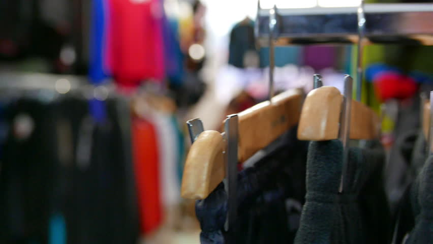 Tourist  outdoor clothes on angers. Panorama in  outdoor shop, blurred scene.,  4K ,3840x2160 | Shutterstock HD Video #9759794