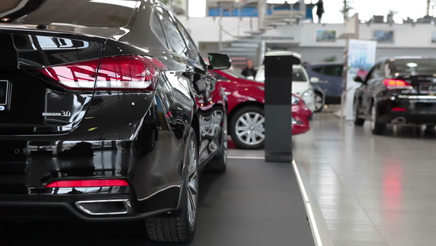 ST. PETERSBURG, RUSSIA - CIRCA APR, 2015: People are in car dealership showroom. The Rolf Lahta is a official dealer of Hyundai | Shutterstock HD Video #9769874