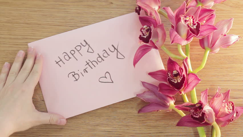 Happy Birthday Card With Flower On The Wooden Background Top View