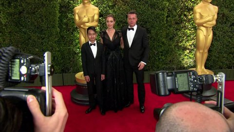 Hollywood, CA - November 16,2013: Angelina Jolie and Brad Pitt and Maddox Jolie Pitt at The Academy's Governors Awards 2013, Dolby Theatre