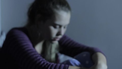 Unhappy Depressed Young Suicidal Teen Girl on Bed Suffering Effects of Bullying