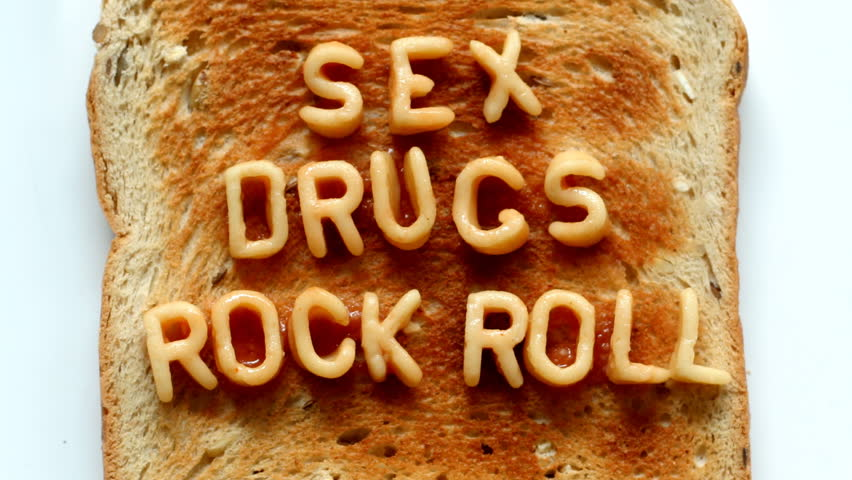 sex drugs rock n roll written with spaghetti pasta letters in tomato sauce on toast