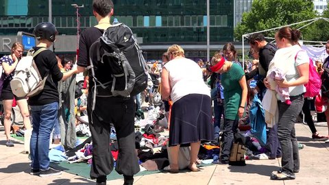 BERLIN- GERMANY, JULY 3, 2014, ULTRA HD 4K Timelapse of people buy vintage clothe on traditional market by day