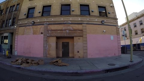LOS ANGELES CALIFORNIA, USA - May 2, 2015: Gritty buildings and sidewalk tents in downtown Los Angeles's skid row neighborhood.
