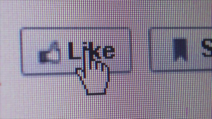 SAN FRANCISCO, CA - MARCH 6 2015: Illustrative editorial clip shows user clicking on Facebook 'Like' button and camera dolly offscreen (several variations); clip highlights role of social media today.