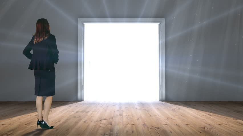 Digital animation of Door opening to light watched by businesswoman | Shutterstock HD Video #9910334