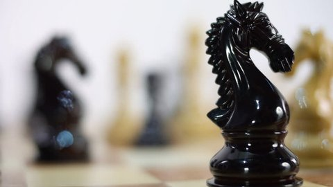Chess Board and Pieces. Black Queen takes White King. Move Queen. Closeup. Shallow depth of field. Dolly shot. Follow focus