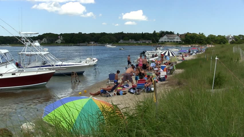 5ac7c63d9c3 Ocean beach August 4th. 2014 Cape Cod Massachusetts. Families and friends  enjoy a relaxing summer day with their boats parked nearby.
