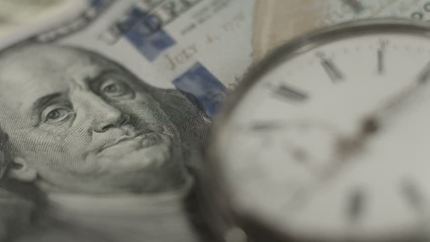 U.S. one hundred dollar bill, pocket watch. Time, money system   Shutterstock HD Video #9979154