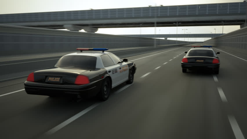 02256 Police Cars In Speed Travelling On Road