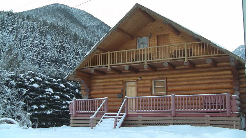 Winter Log Cabin with Snow